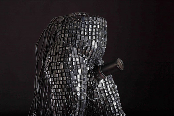 Sculptures and sculptural art created from electronic waste like keyboard pieces, mouse cords, and other discarded technological waste