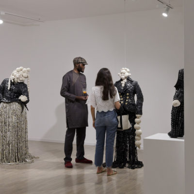 Contemporary African Artist Maurice Mbikayi during his art exhibition Masks of Heterotopia